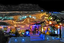 View of the cave at night with the LED lighting