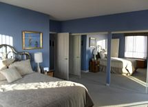extremely large master bedroom with entry to deck