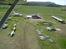 Home on 10 acres of land, two aircraft hangars, shop and turf runway - SOLD